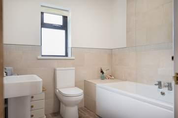 Enjoy a bubble bath in the family bathroom.