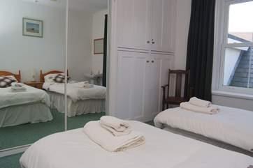 The twin bedroom has plenty of storage space.