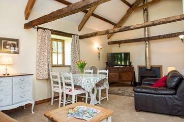The large sitting/dining-room has a wonderful sense of space thanks to the vaulted ceiling.