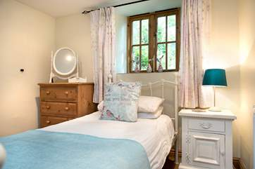 Single bedroom 2 has a pretty bedstead.