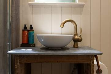 The slate top stand with sink finishes this area perfectly.