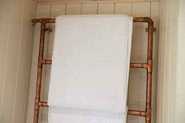 There is even a unique heated copper towel-rail!