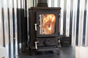 The sweet little wood-burner will keep you nice and toasty in the cooler months.