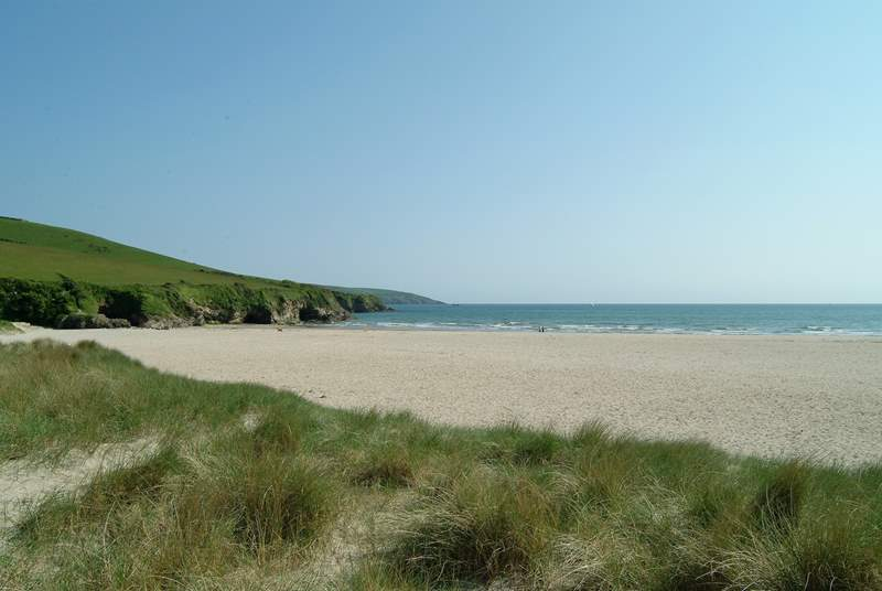 Discover sheltered bays and beaches along this stretch of coastline