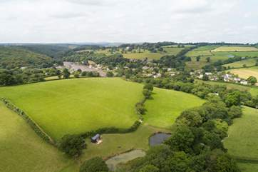 A bird's eye view looking down at Shepherd's Rest with the village or Lerryn inthe background.