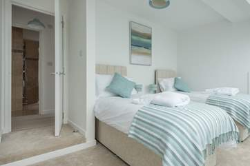 There is a small step into this pretty bedroom which is on the top floor of the cottage.