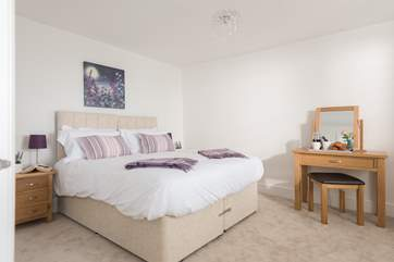 This charming ground floor bedroom can be a king-size bed or zip and link single beds (Bedroom 1).