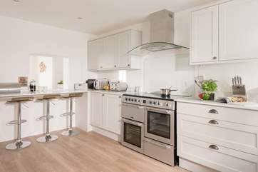 The modern and stylish kitchen has views to the sea too.