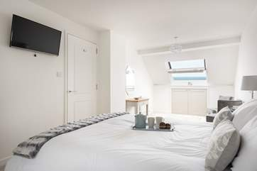 The large master bedroom on the third floor is a calm space to relax (Bedroom 4).