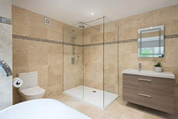 There is a large walk-in shower in this first floor bathroom.