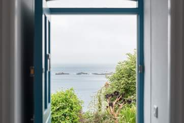 The view from the front door of the cottage, from here you can walk along the coast path to the village and the beach.