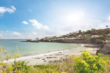 The beach at Coverack is sandy at low tide with a few rock pools to explore.