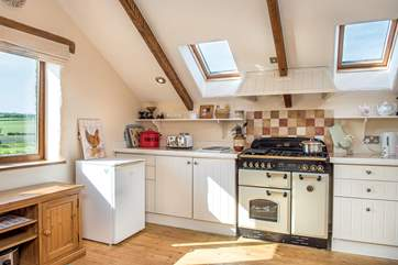 The well appointed kitchen is wonderfully light and airy.