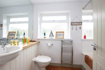 Spacious family bathroom equipped with bath and shower over