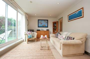 The sitting-room is spacious, light and comfortable