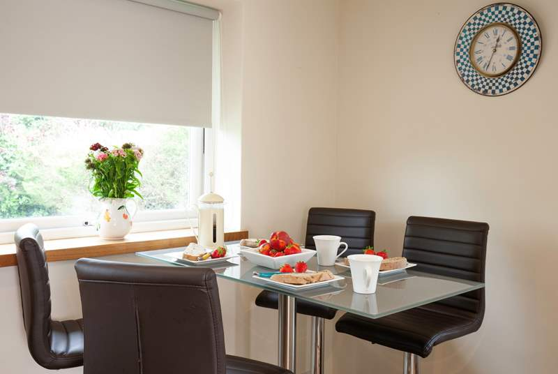 The kitchen / diner has a lovely dining-table to enjoy mealtimes