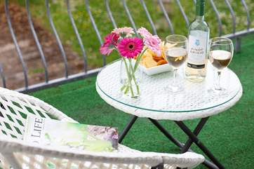 The balcony is a great place to sit back, relax and  enjoy a glass of wine