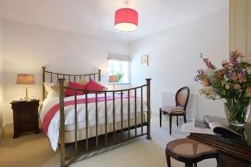 The brass bed has a luxurious Vi-spring mattress.
