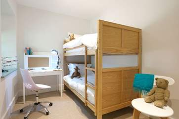 Children will love the touches in the bunk bedroom.