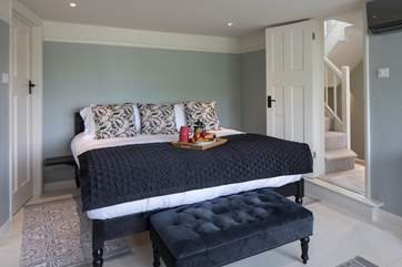The master bedroom has this fabulously huge super-king size bed.