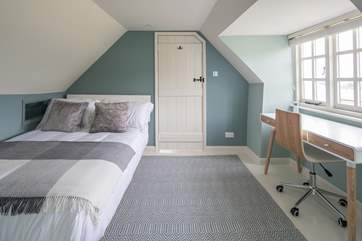 Bedroom 3 is light and airy, furnished with a desk, this is a great spot to catch up on those demanding emails.