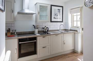 The kitchen is carefully designed and fully equipped to make whipping up a feast a doddle.