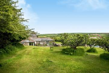Goose Barn enjoys a wonderful rural setting yet is so close to the coast - you can see the sea from the top of the garden.