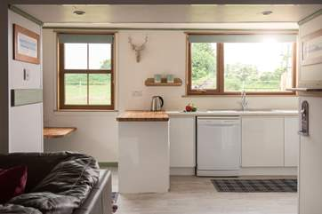 The light kitchen overlooks the garden and field beyond.