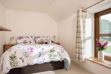 The bedrooms overlook the garden and fields.