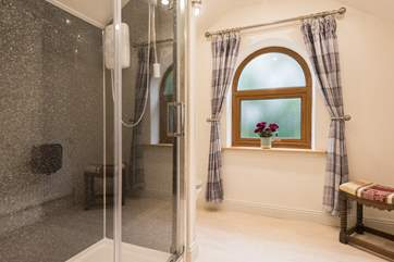 There is a large luxurious shower.