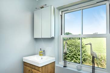 The shower-room enjoys views over the Cornish countryside.