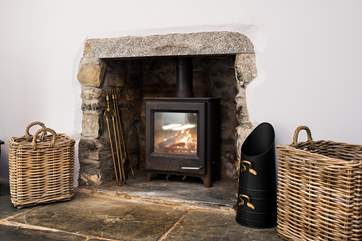 Curl up in front of the toasty wood-burner in the sitting-room.