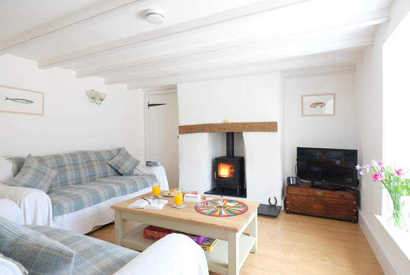 The sitting-room has a cosy wood-burner.