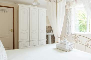The double bedroom has a sink, perfect for brushing those pearly whites before bed.