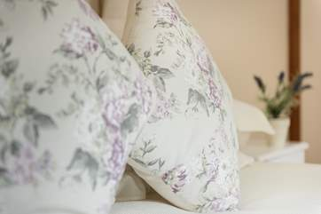 Pretty florals and white linens throughout.