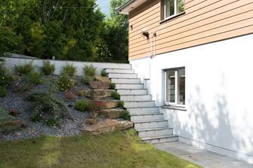 Steps leading down from the driveway to the front of the house, there is no hand rail, so care is needed.