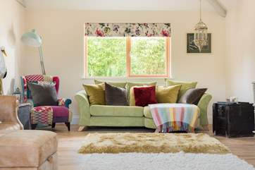 Colourful furnishings bring fun and comfort to this stylish space.