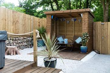 The rear terrace and hot tub area.