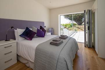 Bedroom 3 is extremely pretty and is rather special as it opens up alongside the pool. Roll out of bed and straight into your swimwear.