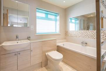The spacious and family-friendly bathroom is perfect for washing away the daily build-up of sand and sun cream.