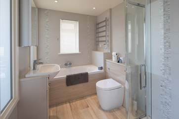 En suite to the master bedroom has a bath and a glorious walk-in shower.