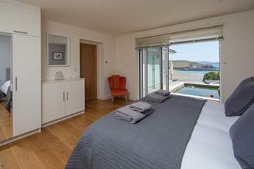 Bedroom 2 offers extra sleeping flexibility as can be configured as a king-sized double, or 2 single beds. This lovely room opens out onto the rear of the house, enjoying views out to sea.