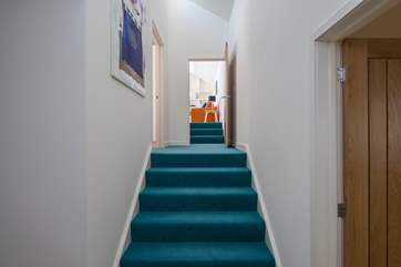 Access to Bedroom 3 and the poolside games-room/snug is up this subtle flight of stairs.