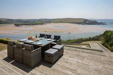 Step out of the living area onto your decked patio and breathe in the sea air.