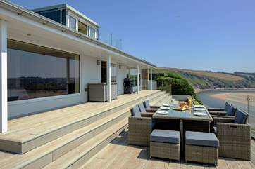 This stunning house stands proudly overlooking the beach and sea.