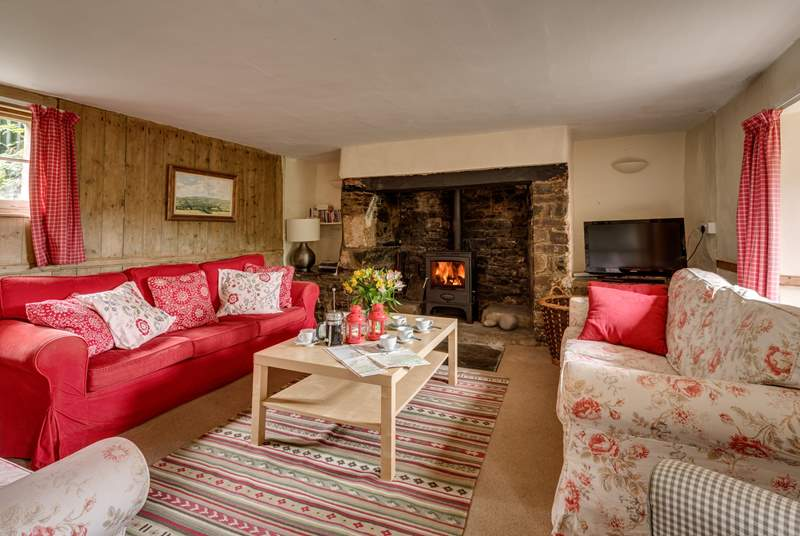 There is a traditional inglenook fireplace and wood burning stove at the heart of this lovely quirky historic house.
