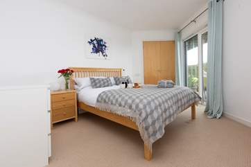 The master bedroom has doors that lead out to the patio and an en suite shower-room.