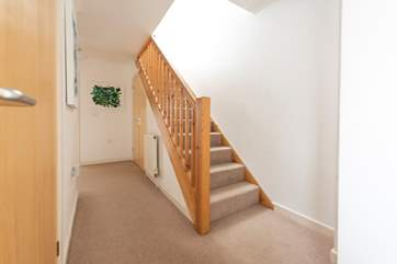 The entrance hall where stairs lead up to the first floor living area.