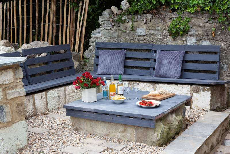 This seating area is perfect for al fresco dining during the long summer days