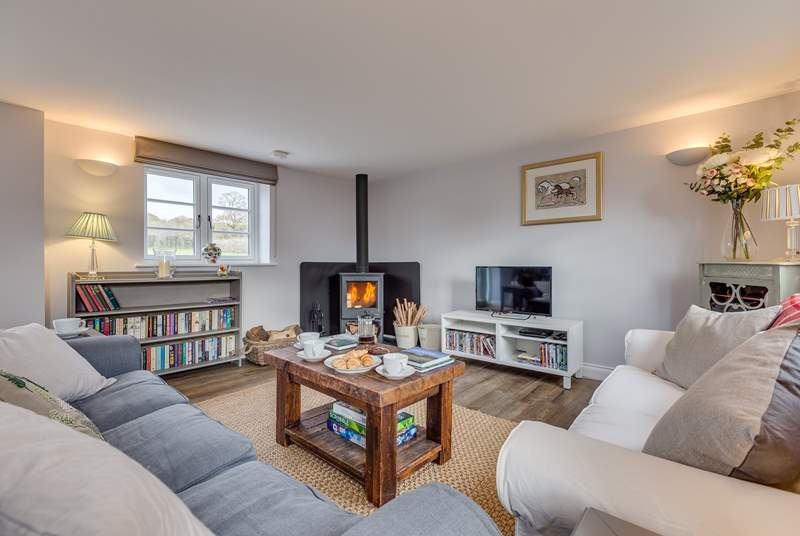 The sitting-room has a wood-burning stove and deep comfy sofas to curl up on.